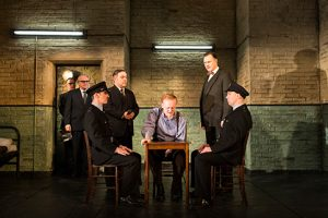 Syd (Andy Nyman), Hennessey (Josef Davies), Harry (David Morrissey) and the Hangmen company. Photo by Helen Maybanks